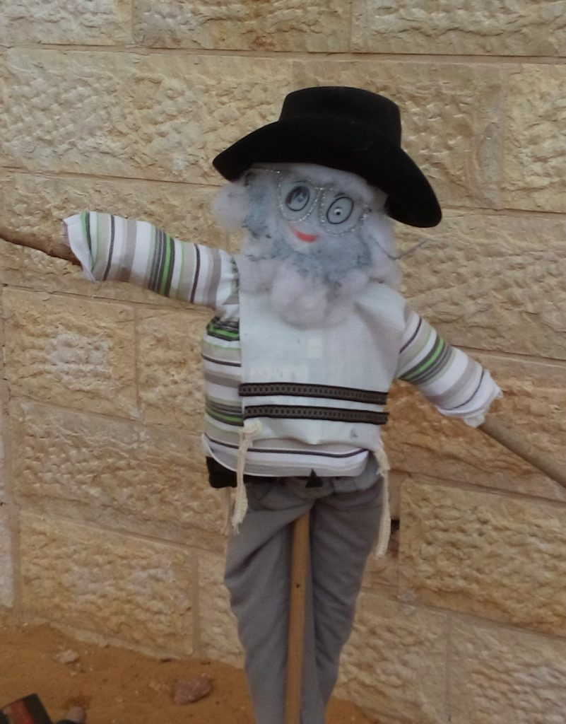 Rabbi Scarecrow protecting the crops